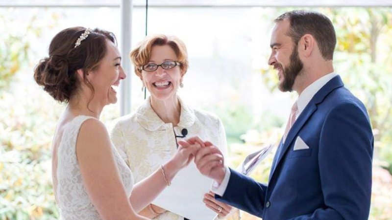 Annemarie Juhlian, Seattle Wedding Officiant with a happy couple holding fingers