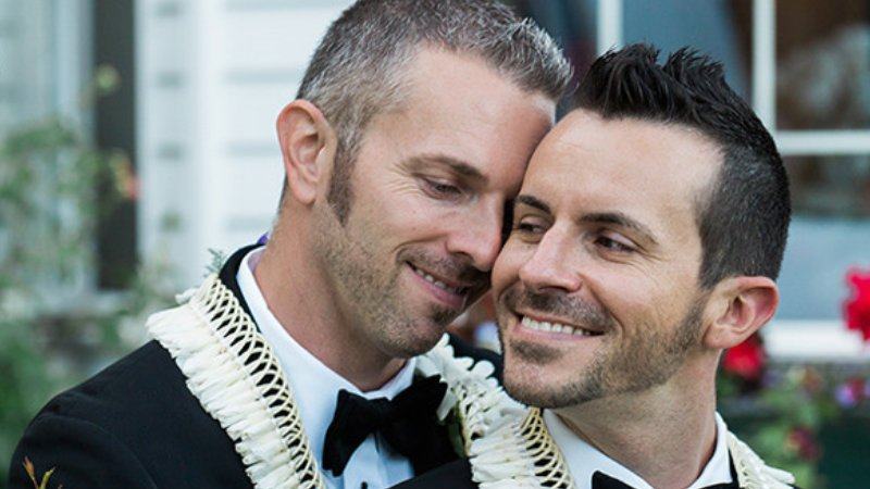 Two great guys loving each other after their ceremony