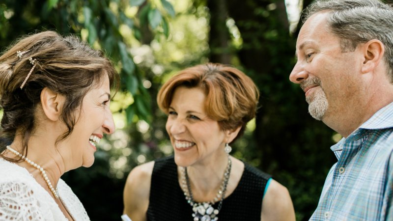 Annemarie Juhlian, Seattle Celebrant and Wedding Officiant with a bride and groom during their wedding ceremony