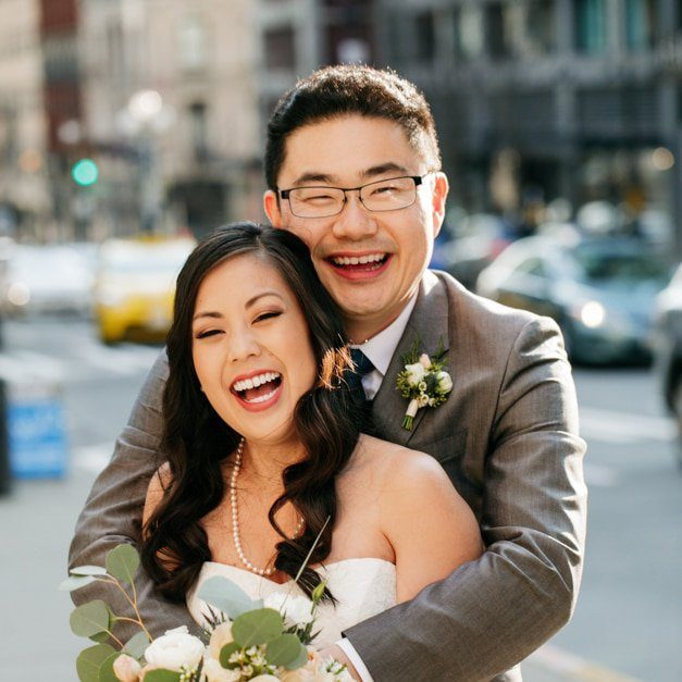 Laughing Asian couple happily married in Seattle